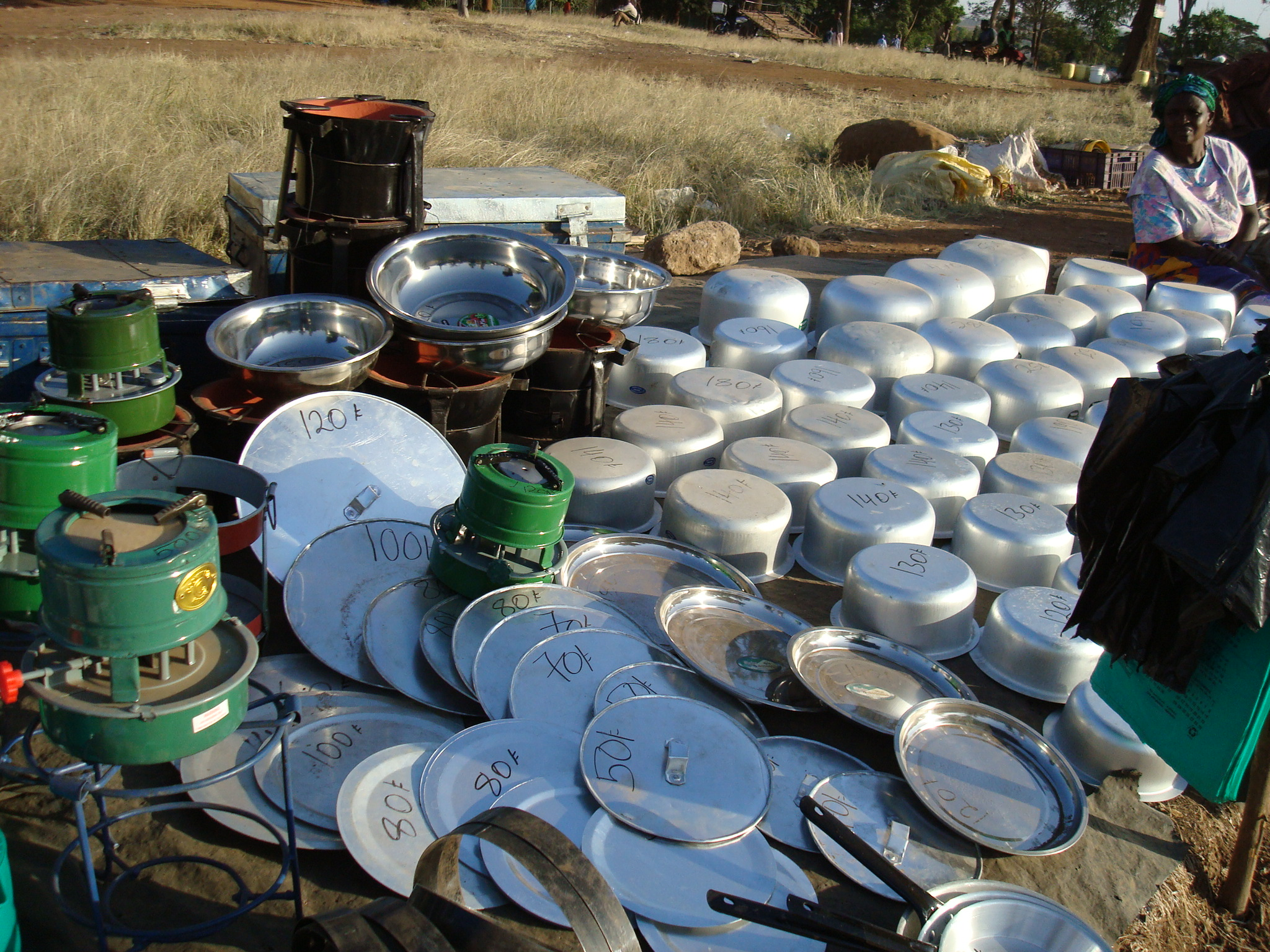 Kitchenware stall at open air market outside Kibera, Nairobi Kenya 23 Jan 2012